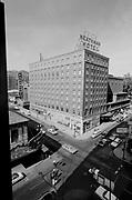 "Ackroyd 12642-014. ""Heathman Hotel. Exteriors. July 12, 1964"" (35mm B&W. SW Broadway & Taylor)"
