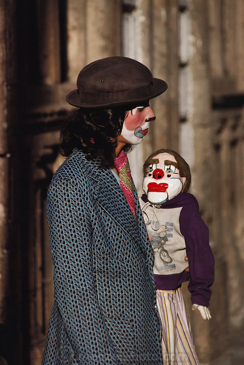 A ventriloquist clown and his dummy on their way to work in Guadalajara, Mexico.