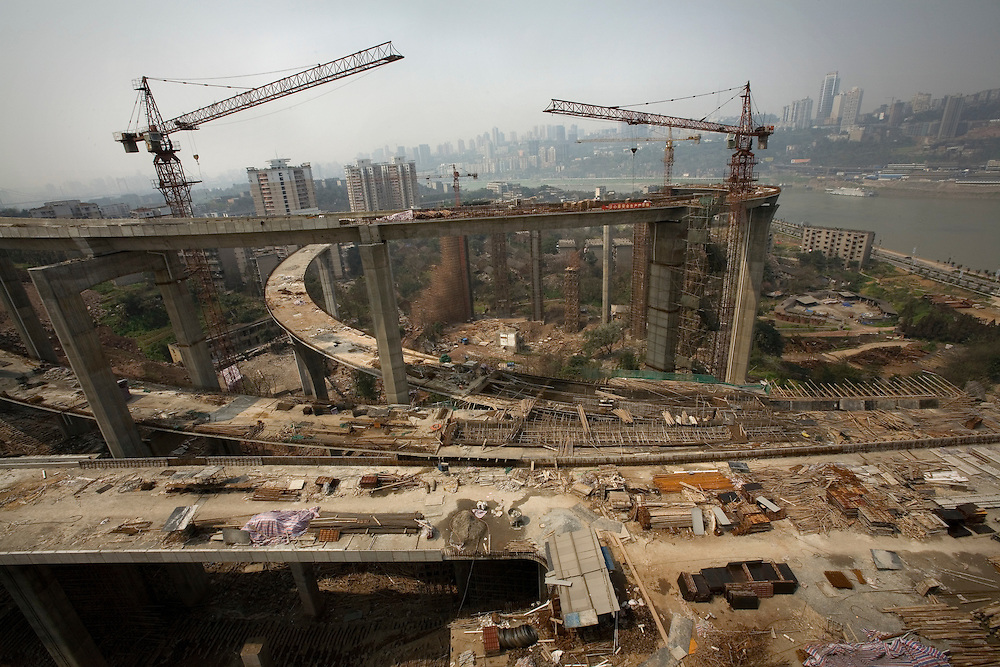 Chongqing is a city of massive building developments. The Shanhu Changjiang Bridge is one such project. It spans the Yangtze River and is connected to an elegant network of new highways, which cut through the old construction of the city, photographed on 20 March 2007.