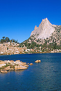 Cathedral Peak rising above the blue-green waters of Budd Lake, Tuolumne Meadows area, Yosemite National Park, California