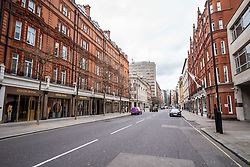 © Licensed to London News Pictures. 13/03/2020. London 11.44, UK. Normally packed with tourists and shoppers Sloane Street in Knightsbridge appears very quiet this morning as Prime Minister Boris Johnson warned that anyone with cold like symptoms should self-isolate as the World Health Organization declares that the Coronavirus disease is a Pandemic. Photo credit: Alex Lentati/LNP