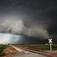 Supercell thunderstorm approaching a railroad crossing in southern Nebraska.