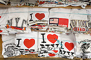 stacks of I Love NY and Chinatown t-shirts