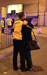 People at Manchester Arena after reports of an explosion at the venue during an Ariana Grande gig.