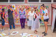 07/09/2015 - Lisbon, Portugal: Lara Seixo Rodrigues, discuss with Lurdes Silva 80, which stencil they will use next during the workshop Lata 65. Lata 65 was project created by Lara Seixo Rodrigues and is a creative workshop teaching street art to senior citizens. (Eduardo Leal)