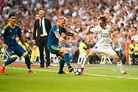Real Madrid's player Luka Modric and Celta de Vigo's player John Guidetti during a match of La Liga Santander at Santiago Bernabeu Stadium in Madrid. August 27, Spain. 2016. (ALTERPHOTOS/BorjaB.Hojas)
