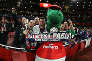 Paris Saint Germain fans look on behind the Arsenal mascot Gunnersaurus before k/o. UEFA Champions league group A match, Arsenal v Paris Saint Germain at the Emirates Stadium in London on Wednesday 23rd November 2016.<br /> pic by John Patrick Fletcher, Andrew Orchard sports photography.
