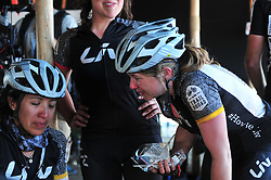 ROBERTSON, SOUTH AFRICA - MARCH 20: From left, Sandra Coronilla from LIV Trail Squad is comforted by team mates at the finish of stage two's 110km from Robertson on March 20, 2018 in Cape Town, South Africa. Mountain bikers from across South Africa and internationally gather to compete in the 2018 ABSA Cape Epic, racing 8 days and 658km across the Western Cape with an accumulated 13 530m of climbing ascent, often referred to as the 'untamed race' the Cape Epic is said to be the toughest mountain bike event in the world. (Photo by Dino Lloyd)