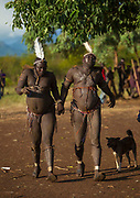BODI TRIBE FAT MEN<br /> (very) big is beautiful<br /> <br /> Every  year,  takes  place  in the deep south of Ethiopia, in  the <br /> remote  area of Omo valley, the celebration of  the  Bodi  tribe  new <br /> year: the Kael.For  6  months  the  men  from  the tribe will   feed   themselves with only fresh  milk  and  blood  from <br /> the cows. They will not  be allowed to  have sex and to go out of their  little hut.  Everybody will take care of  them, the  girls  bringing  milk  every morning in pots or bamboos. The  winner  is  the  bigger.  He  just <br /> wins fame, nothing special. This  area does not  welcome tourists and has kept his traditions<br /> <br /> Photo shows: For  hours  under a  hot  sun, they  will  run  around  a  sacred  tree. Many  walk  like babies, loosing  their <br /> balance...<br /> ©Eric lafforgue/Exclusivepix Media