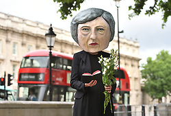 A protest organized by the global campaigning movement Avaaz, on Whitehall in London, of a life-size giant-headed puppet of Theresa May leaving flowers at a tombstone bearing the words Hard Brexit RIP, as her future as Prime Minister and leader of the Conservatives was being openly questioned after her decision to hold a snap election disastrously backfired.