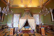 """""""The bedroom of Joachim Murat""""  is decorated in the Empire style and comes from the Royal Palace of Portici, the favourite palace of  Joachim Murat and Caroline Bonaparte. The bed is mahogany designed by French Architedt Leconte.   The Bourbon Kings of Naples Royal Palace of Caserta, Italy. UNESCO World Heritage Site .<br /> <br /> Visit our ITALY HISTORIC PLACES PHOTO COLLECTION for more   photos of Italy to download or buy as prints https://funkystock.photoshelter.com/gallery-collection/2b-Pictures-Images-of-Italy-Photos-of-Italian-Historic-Landmark-Sites/C0000qxA2zGFjd_k<br /> <br /> <br /> Visit our EARLY MODERN ERA HISTORICAL PLACES PHOTO COLLECTIONS for more photos to buy as wall art prints https://funkystock.photoshelter.com/gallery-collection/Modern-Era-Historic-Places-Art-Artefact-Antiquities-Picture-Images-of/C00002pOjgcLacqI"""