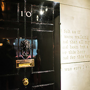 One of the old doors of the Prime Minister's residence at 10 Downing Street on display at the Churchill War Rooms in London. The museum, one of five branches of the Imerial War Museums, preserves the World War II underground command bunker used by British Prime Minister Winston Churchill. Its cramped quarters were constructed from a converting a storage basement in the Treasury Building in Whitehall, London. Being underground, and under an unusually sturdy building, the Cabinet War Rooms were afforded some protection from the bombs falling above during the Blitz.