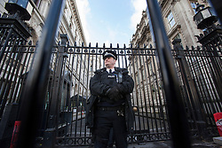 © licensed to London News Pictures. London, UK 17/12/2012. Armed police officers guarding Downing Street on 17/12/12. Photo credit: Tolga Akmen/LNP