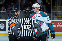 KELOWNA, CANADA - NOVEMBER 11: Referee Reagan Vetter and linesman Dustin Minty speak to Braydyn Chizen #22 of the Kelowna Rockets at centre ice at the end of second period against the Red Deer Rebels on November 11, 2017 at Prospera Place in Kelowna, British Columbia, Canada.  (Photo by Marissa Baecker/Shoot the Breeze)  *** Local Caption ***