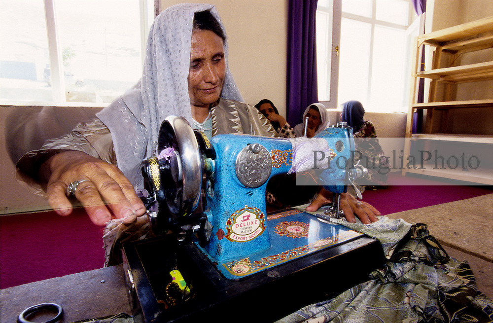 FAIZABAD, 27 July 2005..A woman learns how to sew by machine at the Women Affairs Department.....This is part of the Vocational Training Course, funded by UNFPA and implemented by IBNSINA...The VTC aim is to improve the status of women, by providing them a two-hour daily course on reproductive health, literacy and working skills.