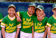 Teammates age 12 on an inner city little league baseball team at Dunning Field.  St Paul  Minnesota USA