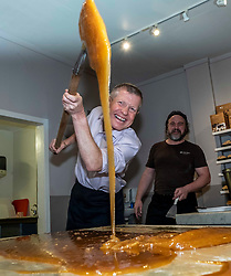 Pictured: Willie Rennie shows what he has learnt under the watchfull eye of master fudge maker Will Tebbutt<br /><br />Scottish Liberal Democrat leader Willie Rennie visited the Fudge Kitchen on Edinburgh's Royal Mile to talk about the need to protect Scottish businesses from independence.  I don't think master fudge maket Will Tebbutt needs t6o worry about his job.<br /><br />Ger Harley | EEm 2 December 2019