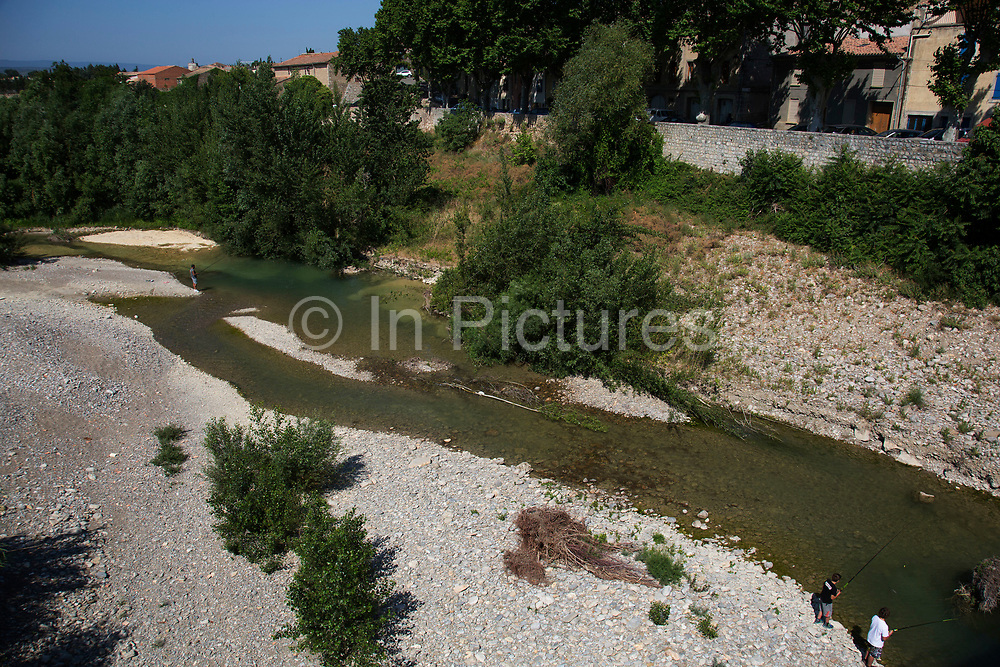 Locals fishing in the river Orbieu Fabrezan, Languedoc-Roussillon, France.