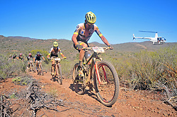 ROBERTSON, SOUTH AFRICA - MARCH 20: Lead by Luis Leao Pinto and Francesc Guerra Carretero lead riders up a singletrack climb during stage two's 110km from Robertson on March 20, 2018 in Cape Town, South Africa. Mountain bikers from across South Africa and internationally gather to compete in the 2018 ABSA Cape Epic, racing 8 days and 658km across the Western Cape with an accumulated 13 530m of climbing ascent, often referred to as the 'untamed race' the Cape Epic is said to be the toughest mountain bike event in the world. (Photo by Dino Lloyd)
