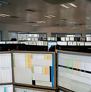 A sea of computer monitors at Liquid Capital, a London derivatives trading company. From the series Desk Job, a project which explores globalisation through office life around the World.