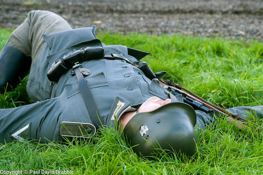 A Re-enactor portrayiing a German infantryman plays dead during a battle battle re-enactment in on Pickering Showground<br /> <br /> 17/18 October 2015<br />  Image © Paul David Drabble <br />  www.pauldaviddrabble.co.uk