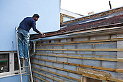 A workman examines the extension roof. Parity Projects offer a rational approach to retrofit advice. This South West London-based company is helping home-owners and social housing providers gear up for the Green Deal by offering tailor-made advice on how best to reduce their fuel bills while doing their bit to tackle climate change. The team first visits to properties to take measurements and find out how clients use their buildings, then inputs the information in to its own specialised software which projects costs and savings for different retrofitting options. So far Parity has given advice to over 700 households as well as 17 social housing providers covering upwards of 240,000 homes, as well as training over 500 people in retrofit.