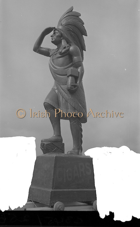 09/04/1964<br /> 04/09/1964<br /> 09 April 1964<br /> Cigar Store Indian statue at Dundalk for P.J. Carroll and Co.