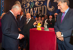 Embargoed to 0001 Tuesday November 13 The Prince of Wales meeting puppets Sooty and Sweep after the We Are Most Amused and Amazed performance at the London Palladium.