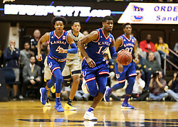 Jan 15, 2018; Morgantown, WV, USA; Kansas Jayhawks guard Malik Newman (14) dribbles the ball up the floor during the first half against the West Virginia Mountaineers at WVU Coliseum. Mandatory Credit: Ben Queen-USA TODAY Sports