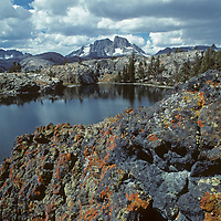 Clouds float above Summit Lake, The Minarets and Mounts Ritter and Banner in Ansel Adams Wilderness in California's Sierra Nevada.