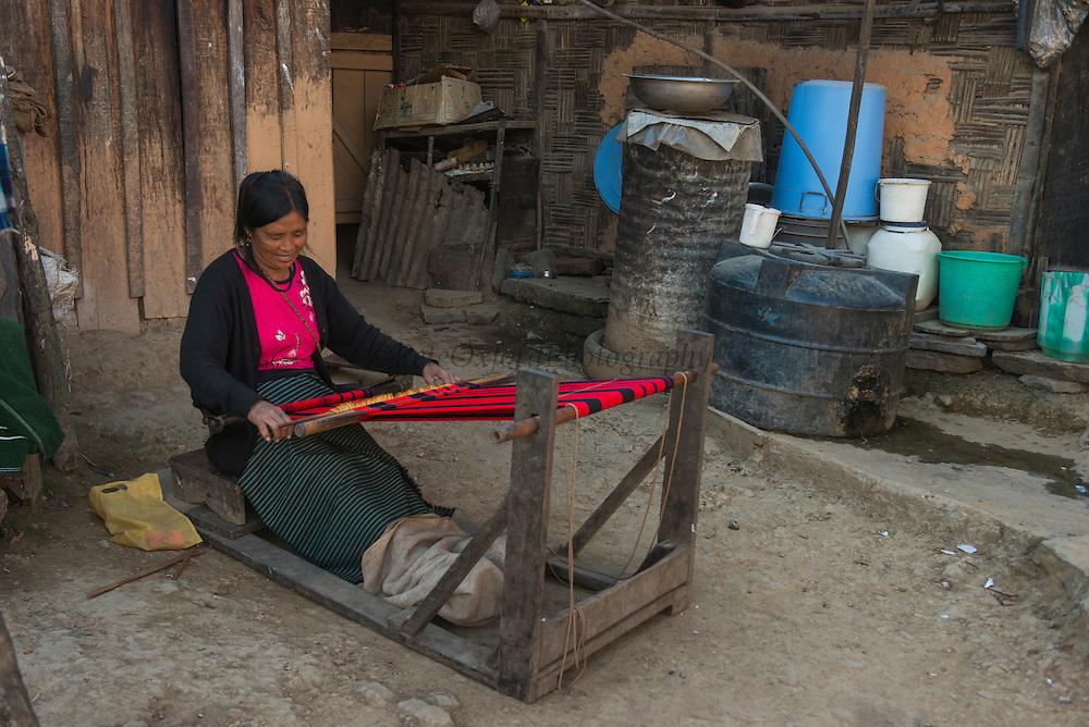 Chang Naga weaver<br /> Chang Naga headhunting Tribe<br /> Tuensang district<br /> Nagaland,  ne India