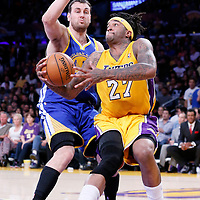 11 April 2014: Los Angeles Lakers forward Jordan Hill (27) drives past Golden State Warriors center Andrew Bogut (12) during the Golden State Warriors 112-95 victory over the Los Angeles Lakers at the Staples Center, Los Angeles, California, USA.
