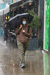 © Licensed to London News Pictures. 10/09/2021. London, UK. A man shelters from the rain underneath an umbrella in north London, as wet weather conditions continue after a recent mini heatwave in London. Photo credit: Dinendra Haria/LNP