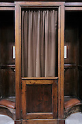 close up of a confession booth