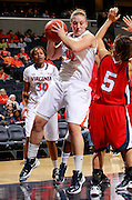 CHARLOTTESVILLE, VA- December 7: Kelsey Wolfe #10 of the Virginia Cavaliers grabs a rebound next to Reagan Miller #5 of the Liberty Lady Flamesduring the game on December 7, 2011 at the John Paul Jones arena in Charlottesville, Va. Virginia defeated Liberty 64-38. (Photo by Andrew Shurtleff/Getty Images) *** Local Caption *** Kelsey Wolfe;Reagan Miller