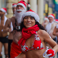 """People participate in a half naked """"Santa run"""" in Budapest, Hungary on December 11, 2011. ATTILA VOLGYI"""