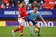 Charlton Athletic defender Patrick Bauer (5) challenges Accrington Stanley forward Luke Armstrong (39) during the EFL Sky Bet League 1 match between Charlton Athletic and Accrington Stanley at The Valley, London, England on 19 January 2019.