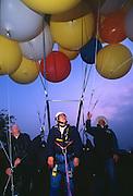 John Ninomiya, a cluster balloonist makes a pre-flight check before soaring above the San Joaquin valley near Coalinga, California.