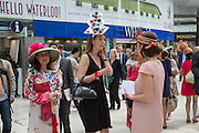 FRENCH RACEGOERS ALL WEARING HATS BY POPPINS MILLINERY, Royal Ascot racegoers at Waterloo station. London. 20June 2013.