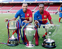 Fotball<br /> Frankrike<br /> Foto: DPPI/Digitalsport<br /> NORWAY ONLY<br /> <br /> FOOTBALL - MISCS 2008/2009 - FC BARCELONA - 29/05/2009 <br /> <br /> THIERRY HENRY AND ERIC ABIDAL WITH TROPHIES WINNING THIS SEASON BY FC BARCELONA