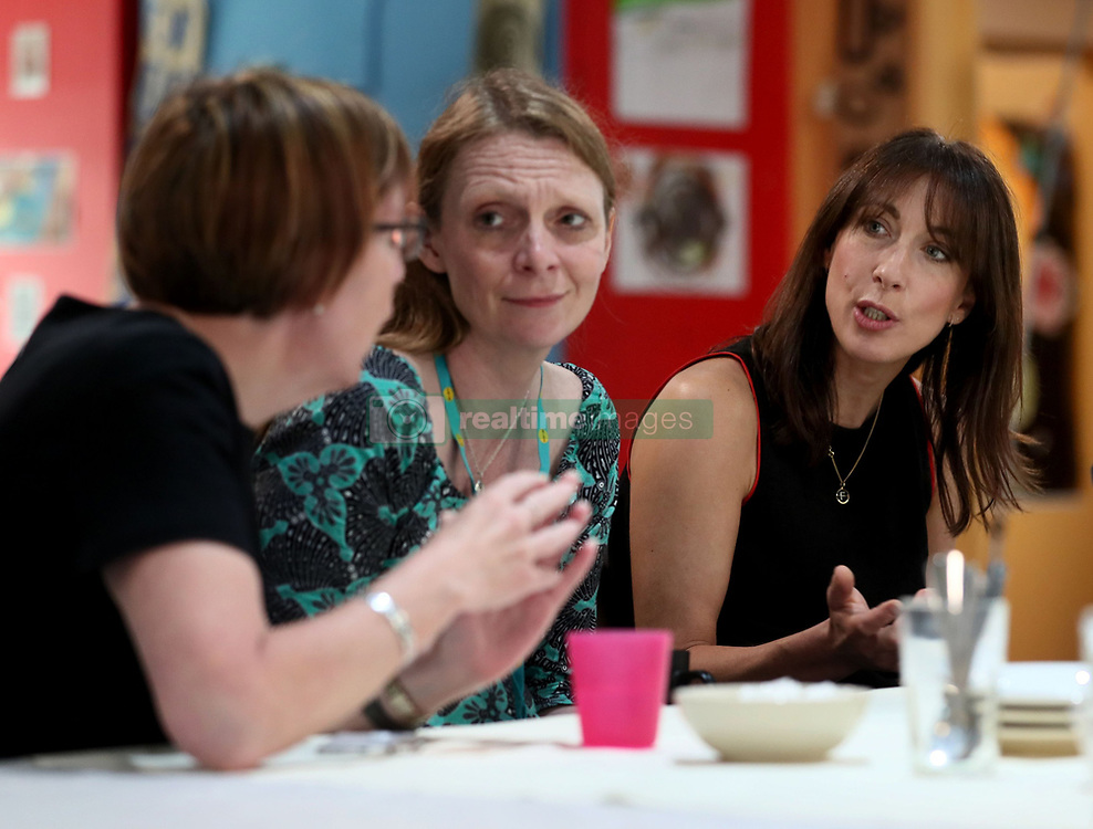 Samantha Cameron (right) hosts a coffee morning to celebrate the work of charity KIDS and the services that they deliver to disabled children, young people and their families, at Hackney Adventure Playground in London.
