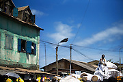 King Nana Kodwo Conduah VI, from the nearby town of Elmina, stands in a palanquin carried by supporters during the parade held on the occasion of the annual Oguaa Fetu Afahye Festival in Cape Coast, Ghana on Saturday September 6, 2008.