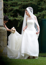 © London News Pictures. 14/09/2013.  The bride after the wedding. The wedding of Euan Blair, Son of former British Prime Minister Tony Blair,  to Suzanne Ashman at All Saints Parish Church in Wotton Underwood, Buckinghamshire. The wedding was attended by Former British Prime minister Tony Blair and his wife Cherie Blair. Photo credit: Ben Cawthra/LNP