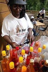 Man making soft drinks at the St Anns; Nottingham Holding Hands festival,