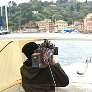 Man photographing a view from boat