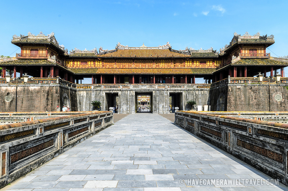 The Citadel gate from across the bridge at the Imperial City in Hue, Vietnam. A self-enclosed and fortified palace, the complex includes the Purple Forbidden City, which was the inner sanctum of the imperial household, as well as temples, courtyards, gardens, and other buildings. Much of the Imperial City was damaged or destroyed during the Vietnam War. It is now designated as a UNESCO World Heritage site.