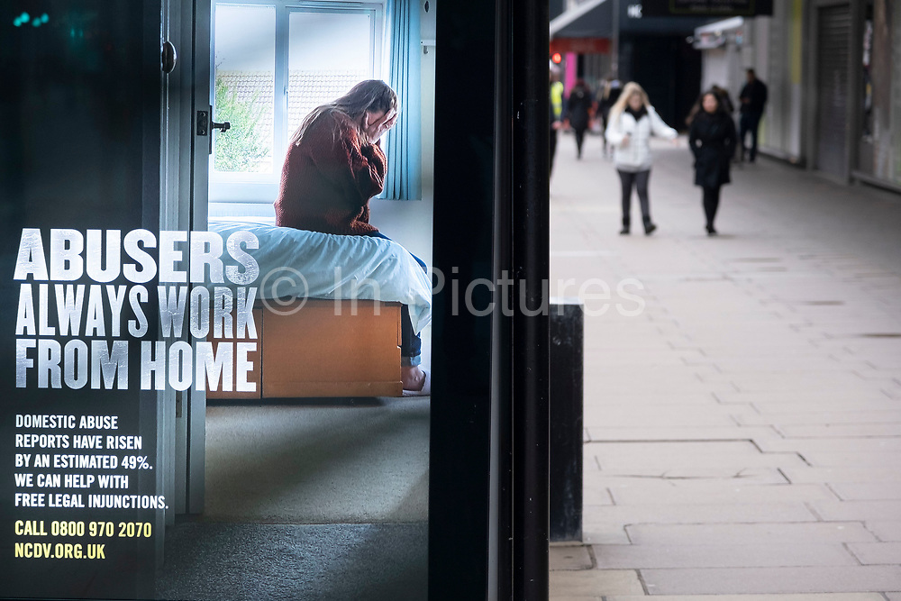 Bus stop advertisement for the National Centre for Domestic Violence  or NCDV as the national coronavirus lockdown three continues on 4th March 2021 in London, United Kingdom. Domestic violence in the UK has seen a marked increased during the national lockdowns. With the roadmap for coming out of the lockdown has been laid out, this nationwide lockdown continues to advise all citizens to follow the message to stay at home, protect the NHS and save lives.