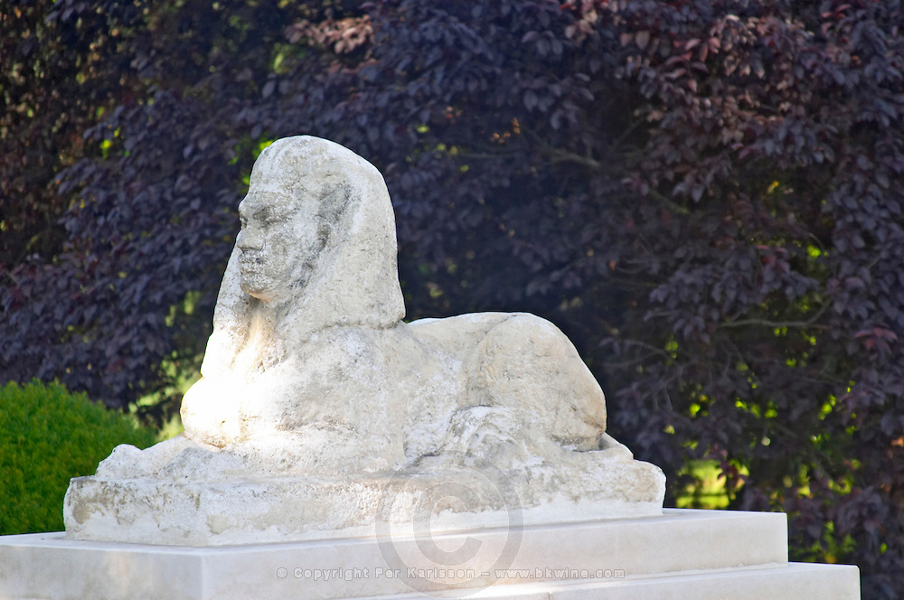 Stone Statue of a Sphynx sphinx sfinx at the entrance to the park at Chateau Mouton Rothschild Pauillac Medoc Bordeaux Gironde Aquitaine France