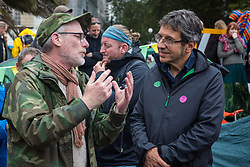 London, UK. 7 October, 2019. George Monbiot (r) speaks to climate activists from Extinction Rebellion blocking Millbank in front of Lambeth bridge on the first day of International Rebellion protests to demand a government declaration of a climate and ecological emergency, a commitment to halting biodiversity loss and net zero carbon emissions by 2025 and for the government to create and be led by the decisions of a Citizens' Assembly on climate and ecological justice.