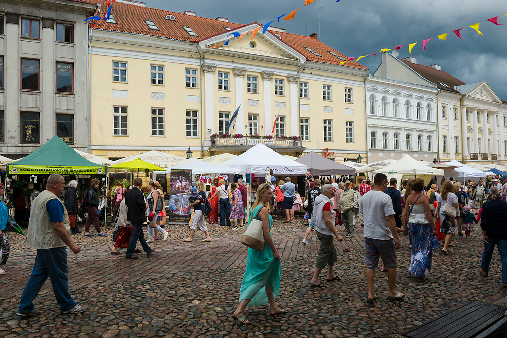 Tartu, Estonia - July 11, 2015: People walk in Raekoja plats, the old town square, in the Estonian city of Tartu. The city is known for its university and is sometimes referred to as the country's spiritual capital.